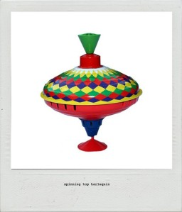 spinning-top-harlequin-tin-toy-polaroid-www_childrensdept_com_au